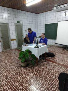 Na mesa das deliberações: consócia Leni (primeira secretária), padre Alexandre (assessor Espiritual) e confrade Cristian (presidente nacional)